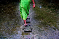 Women walking on stepping stones