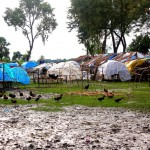 Image of tents on sodden ground