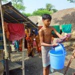 Image of boy at water well