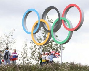 Visitors pose with Olympic rings at London Olympic Park