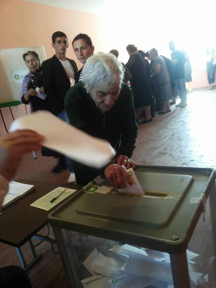100 year old Georgian woman voting in the elections